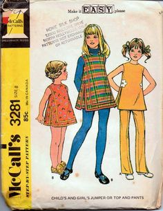 McCall's 3281 - Young girls' jumper dress, pants and top vintage 1970's sewing pattern.  Pattern is partially cut and complete.