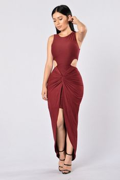 - Available in Burgundy, Black, and Olive - Side Cutouts - Knot Detail - Hi Low Hemline - Maxi Length - 96% Polyester, 4% Spandex