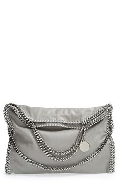 Stella McCartney 'Falabella' Shaggy Deer Foldover Tote at Nordstrom.com. A shimmer-struck tote ups the ante with street-chic styling, trimmed in silver-link chains that drape against the slouchy, fold-over silhouette. Carry on your arm with the shorter straps or use the fold-over chain for a shoulder style.