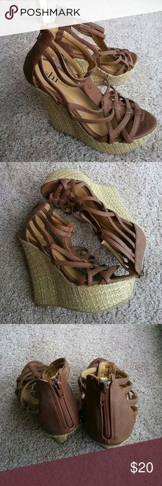 Impressive Detailed Wedge Sandals Planning on escaping the winter cold, but don't have the perfect resort shoes yet? You're in luck! With the criss-cross straps, textured wrapped heel, and height for miles, you'll be turning heads when you model walk through the sun! Tread a bit stained with light wear but grip in excellent condition, and zipper at heel makes for easy wearing. Shi by JOURNEYS Shoes Wedges