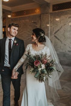 mood | bride and groom | hand holding | bouquet | boho | long sleeve dress | brunette updo