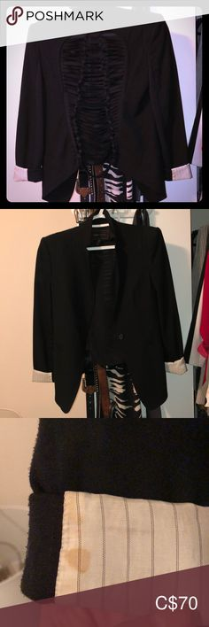 BCBG thrashed out back blazer Black fitted blazer, structured shoulder pads. Thrashed our back, longer in the front, shorter in them back. Small mark on the inside of the right sleeve. Picture shows Jackets & Coats Blazers Black Fitted Blazer, Green Blazer, Floral Blazer, Striped Blazer, Plaid Blazer, Black Blazers, Corduroy Blazer, Cotton Blazer, Equipment Blouse