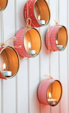 create luminaries with cleaned tuna cans- this would be a cute idea to do on an outdoor wall for an alfresco dinner...