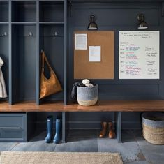 "RACHEL ROSENTHAL on Instagram: ""I just adore how this mudroom has a built in family command center. I always recommend putting a family calendar, chores, schedule and more…"" Overhead Storage, Bench With Storage, Built In Lockers, Mud Room Garage, Home Command Center, I Heart Organizing, Clayton Homes, House Photography, Family Organizer"