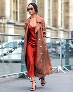 Love this long, red silk slip dress paired underneath a brown trench coat! So gorgeous