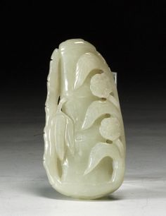 Shadowbox frame something like this as art.  Chinese White Jade Pendant - Bamboo With Flowers