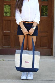 Back to Class Classics. A white Polo or Lacoste shirt, navy shorts, a brown belt, a watch & hair wrap on one hand an a pearl bracelet on another