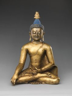 Buddha Sakyamuni, 12th–13th century. Central Tibet. Brass with color pigments.