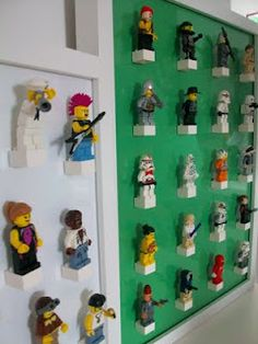 Minifigure storage -get a glass picture frame... put the color of paper you want inside the frame. super glue the bricks to the glass and snap your figures into the bricks!