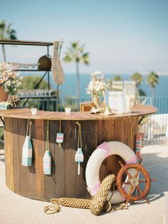 Keep the nautical theme up at the wedding bar with life savers, shells, and ship wheel Nautical Wedding Inspiration, Backyard Beach, Nautical Party, Nautical Wedding Decor, Vintage Nautical, Beach Bars, Coastal Decor, Coastal Cottage, Coastal Homes