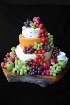 Tower of cheese! Fabulous for both weddings and parties.  I find this tends to…