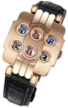 Harry Winston Opus 3 is the brain child of Vianney Halter and features six porthole displays. Each of the displays relies on its own jumping indicator to show the hour in the top left and right windows (blue), minutes in lower left and right (black), and date in the vertical center displays (red).