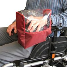 "7 Wheelchair accessories. From Active Mobility, a waterproof ""glove"" for power chair users protects your hand and joystick control from the weather"