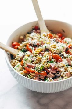 The BEST Italian Pasta Salad - with pasta, tomatoes, fresh mozzarella, spicy salami, parsley, olives, and easy Italian dressing. Super versatile to what you have on hand! #pastasalad #pasta #salad #summer #recipe #italian | pinchofyum.com
