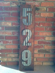 Address marker with corrugated steel and old wood