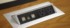 """""""hide away"""" power in tables with USB (for charging mobile phones) as well as AC outlets"""