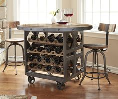 Handcrafted from a reclaimed industrial textile mill cart with a forged steel base wine rack that holds up to 36 standard wine bottles.