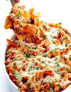 CHICKEN PARMESAN BAKED ZITI   ~  12 oz. penne ziti (or any pasta shape)...2 c. shredded, cooked chicken (abt. 2 small chicken breasts)...1 (25 oz) jar DeLallo Pomodoro Fresco tomato-basil pasta sauce)...1-1/2 c. shredded low-fat mozzarella...1/3 c. freshly-grated Parmesan cheese...1/4 c. packed fresh basil leaves, roughly chopped
