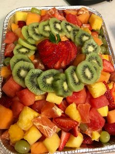 Fruit salad with pretty design on top.