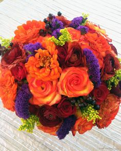 Bridal bouquet with orange zinnias! Perfect for late summer and early fall wedding.