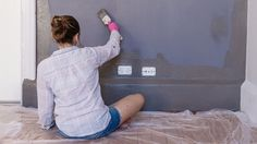 woman painting house home makeover