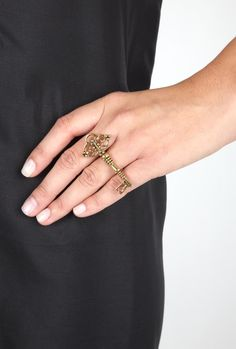 Keys hint that there's something to be discovered - they're really popular right now, and this multi-finger ring is no exception!