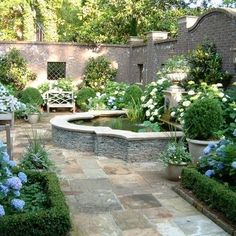 Brick walled courtyard; pond; fountain; love the openings in the brick wall