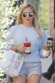 Hilary Duff steps out in tiny denim shorts with two juices in LA #dailymail