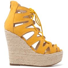 Yellow suede lace-up platform with elegant cuts and rope platform decoration. Fastens with zipper at the back.