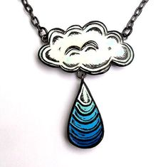 "Stunning --- Sometimes the rain brings the blues.    This listing is for a necklace with a 1.5"" x 2"" pendant cutout created in a black polymer clay with white, and several shades of blue acrylic paint. The cloud and raindrop are an original design and were created with a hand carved stamp. The pendant is distressed and sealed with a clear gloss sealer. Due to the random nature of distressing, each pendant will be slightly different. The pendant is strung on a 16"" gunmetal finish chain with a…"