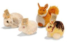 THREE STEIFF POM-POM RABBITS AND ONE SQUIRREL: one white, (2504,1); one white and brown, (2504,2); and one yellow, brown and white, (2504,3), all with FF button and cream card tags, 1931-43 --2in. (5cm.) long; and Squirrel, (3506), FF button, 1933-41 --2¾in. (7cm.) high (4)