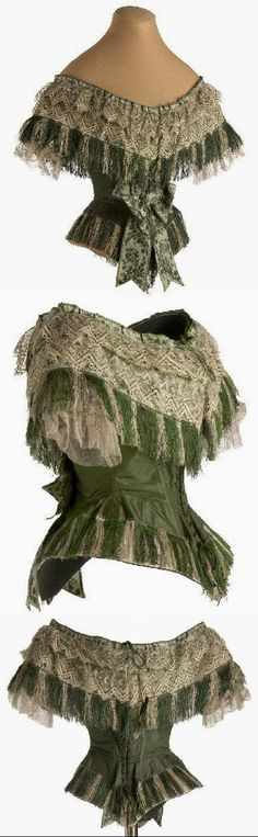 Evening bodice, 1855-65, silk, whale boned, 19''/49 cm waist. Waistband inside with a bracket. Back closure with 20 pairs of eyelets, original tape has aiguillettes (refined metal tips). Bertha is formed with overlapping strips of silk, lace, fringe and mechanical flywheel tulle. Entire lower body contour is trimmed with silk fringe. Short sleeves hidden by bertha, adorned with a ribbon and double pleated tulle application, the cuff closes with a small pearl button. In the Swan's Shadow.
