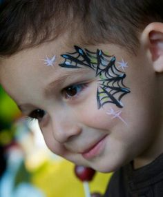 Spider web face paint eye design. Great for boys