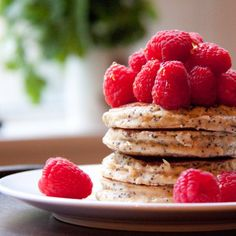 Healthy lemon and poppy seeds pancakes made with oats, Greek yogurt and grated apple. Gluten free.