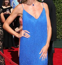 Pin for Later: Is Heidi Klum Having TOO Much Fun in That Dress?! Or that three-stone sapphire ring. Another loaner from jeweler Lorraine Schwartz.