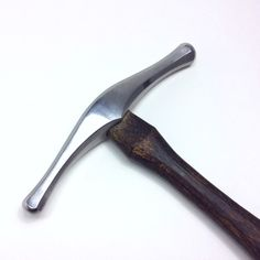 - Made of chrome-moly 4140 - Handle is made of Hickory wood, 14in - Made to order - please allow 14 days for production