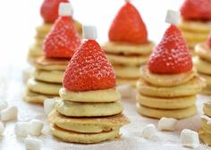 These mini pancake stackers topped with strawberry Santa hats make a really fun festive breakfast for kids. Perfect for a North Pole breakfast too!