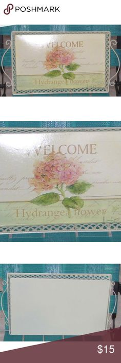 "Hydrangea Flower Welcome Metal Serving Tray Hydrangea Flower Welcome Tray  Measures approx 14"" x 8""  Metal with cutout side detail  Hydrangea flower print with words in the background  Excellent condition Other"