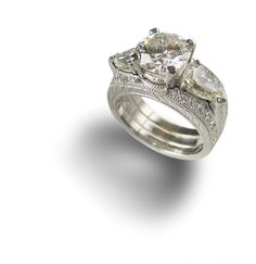 Platinum diamond engagement ring with two pave set diamond bands.