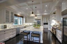 Gourmet: The bright white kitchen has top appliances and marble countertops
