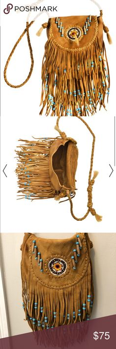 Kobler leather Native American leather bag! Practically new! Only used 3 times and was purchased 4 months ago. This bag is stunning and so soft. I trimmed off the horse hair since it wasn't to my liking other than that the bag is identical. 🧡🧡🧡 Add a boho touch to your outfit! ✨✨ Enjoy this creation from Kobler Inc. This bag is made in butter-soft cowhide with the cover flap embellished with handcrafted sand bead rosettes and long fringes. Bone and glass beads are threaded throughout the…