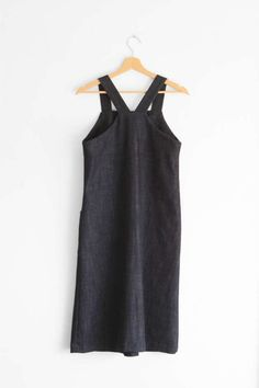 A line shaped cut apron dress in a medium weight denim. It features 2 patch pockets, racer back, no buttons closure. It is a pullover dress. So easy to throw on and you add a neat style to your everyday outfit. It can be worn all year round. Care: machine wash 30°C, mild soap, tumble dryer allowed. Hang to dry in the shadow. Ironing required.  NOTE: Indigo dye is a very deep and intense dye so the fabric will fade a little with each wash to give a comfortable, worn appearance. As it is a…