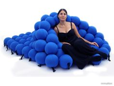 """Feel"" is an innovative seating system designed by Animi Causa, featuring an unique shape inspired by the molecular structure.  It consists of 120 foam balls covered by soft stretch fabric and connected by plastic elements."