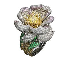 Giampiero Bodino Primavera white and yellow gold ring with white, grey, yellow and cognac diamonds, pink sapphires, emeralds and a central yellow diamond. Image: Laziz Hamani