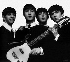 The Boys with a Rickenbacker 425 guitar