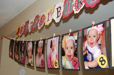1st birthday idea: Month-by-month pictures and birthday banner.