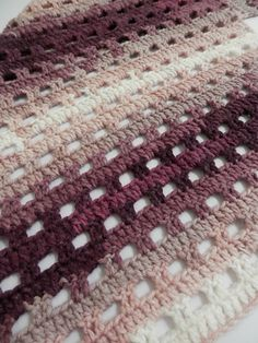 The Heathered Eyelets Wrap is modern, beautiful and easy to work up. Basic stitches produce beautiful eyelets, making it a fun project to crochet and is perfect for anytime of year. Self-striping yarn is a great option for this pattern, but it would equally beautiful in a solid color yarn too!