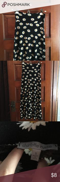 """Daisy Maxi Skirt Black daisy maxi skirt with white daisies on it. Size small. Fits like an extra small. This is a re-posh. Selling only because it is a bit too short for me. It hits right about my ankles and I like my maxis to almost touch the ground. I'm 5'6"""". No holes, tears, etc. Good condition. Open to reasonable offers. No trades. Charlotte Russe Skirts Maxi"""