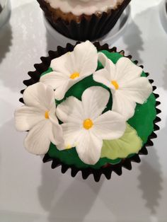 White Blossom on Green Icing Cupcake by Mini's Bakery