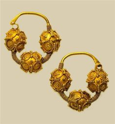 Temporal rings,12th century  Gold, embossing, filigree, granulation  4.3 x 4.3 cm  State Museums of the Moscow Kremlin  One of the most common types of female ornaments, which were attached to the headdress. Dates back to ancient Slavic culture VII — VIII centuries